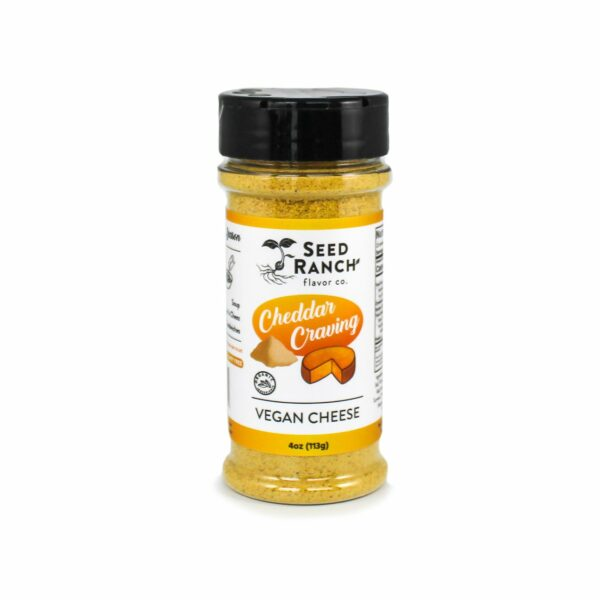 Cheddar Craving Vegan Cheeze Powder by Seed Ranch Flavor Co. comes in a sealed container with a lid