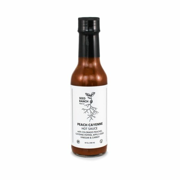 Peach Cayenne Hot Sauce By Seed Ranch Flavor Co. comes in a glass bottle with a seal